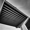 Structure of a bridge with the sky in the background. Black and white photography.