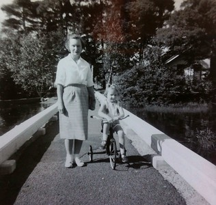 Wilma and Jenny Stone,  circa 1959;  Learned to ride a tricycle, ride a bicycle and drive a car at the camps
