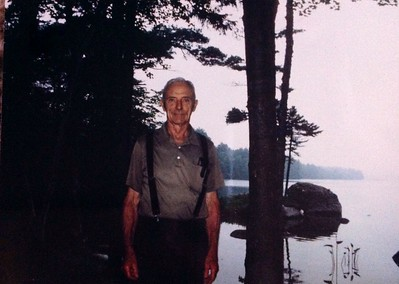 Charles Stone, in front of cabin #105, 1987