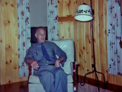 Ralph Benjamin, relaxing in one of the cabins, 1964