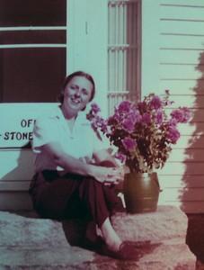 Joanna Benjamin on the front steps, 1955