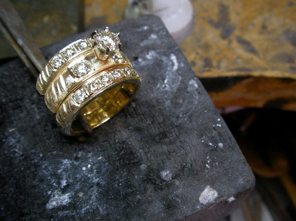 Another of the completed wedding set with the center stone set in place.