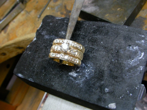 The completed wedding set with the center stone set in place.