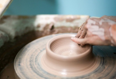 Emily Brooks works on a piece at Stoneware Alchemy Clay Studio in Canton, CT.  Photo by John Fitts