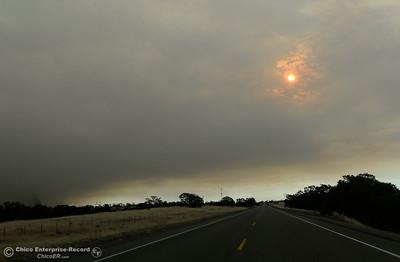 The sun peeks through smoke as the Stoney Fire burns above Upper Bidwell Park near Chico, Calif. Friday July 13, 2018.  (Bill Husa -- Enterprise-Record)