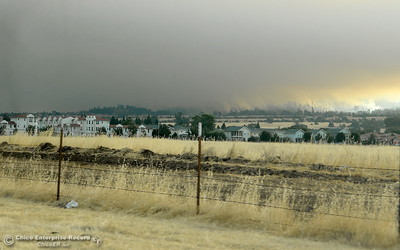 Smokey skies are seen behind the Doe Mill Neighborhood as the Stoney Fire burns above Upper Bidwell Park in Chico, Calif. Friday July 13, 2018.  (Bill Husa -- Enterprise-Record)