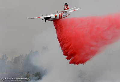 CAL FIRE Tanker 93 makes a drop on the Stoney Fire above Upper Bidwell Park seen from Hwy. 32 near Chico, Calif. Friday July 13, 2018.  (Bill Husa -- Enterprise-Record)