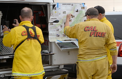 Fire officials gather at the command post along Hwy. 32 as the Stoney Fire burns in Upper Bidwell Park near Chico, Calif. Friday July 13, 2018.  (Bill Husa -- Enterprise-Record)