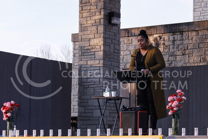 """During her speech, Sheila Ellis-Glasper said she was standing up in front of the crowd gathering in City Park as a representative of her mother Emily, who left her home to come to America. Ellis-Glasper said her mother shares """"commonalities"""" with the women who were murdered on March 16 in the shooting spree. (Kaylie McLaughlin   Collegian Media Group)."""