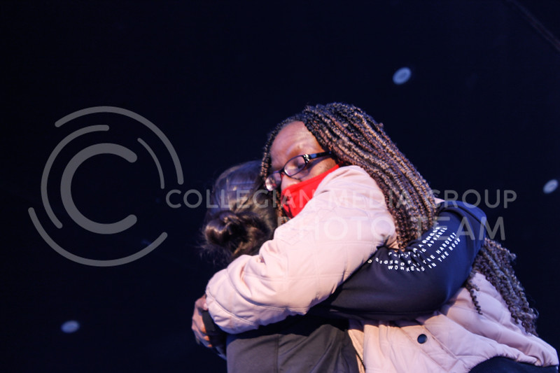 At the conclusion of the Stop AAPI Hate Flashlight Vigil, BLM MHK cofounder Teresa Parks hugs event organizer Fanny Fang. (Kaylie McLaughlin   Collegian Media Group)
