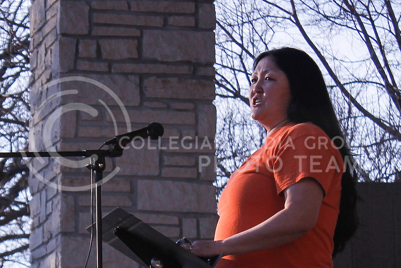 Kim Zito, chair of the Riley County Democratic party, discussed her experience of realizing she was adopted because of bullies. She said growing up, she felt like she had to make jokes about Asian people to fit in with her peers. Zito was one of a handful of speakers that shared their experiences being Asian American at the Stop AAPI Hate Vigil on March 28 in City Park.  (Kaylie McLaughlin   Collegian Media Group)