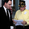Senator Nichols aid talks with WWII veteran Roy Hughes