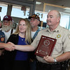 Captain Mike White of the Montgomery County Constables Pct. 2 Office, is  presented with a plaque of appreciation by the Southeast Texas Patriot Guard Riders