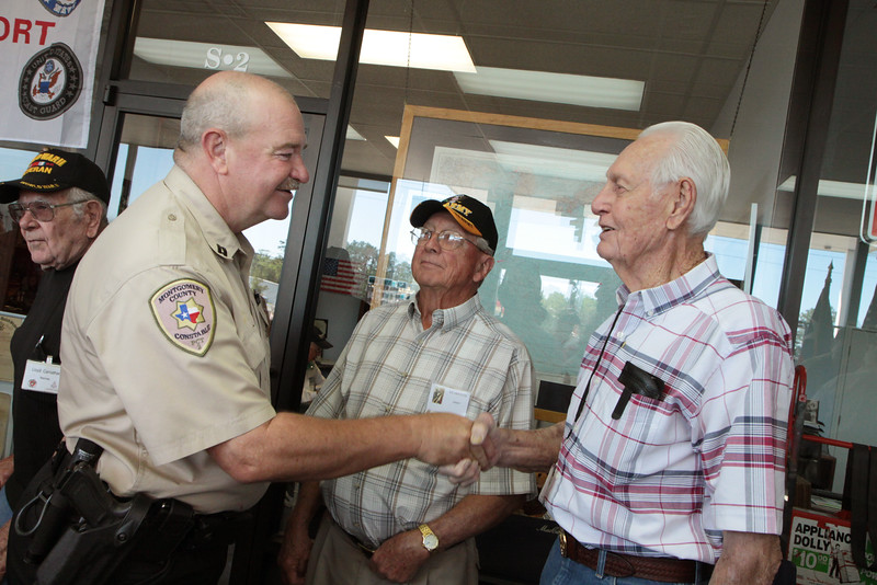 Captain Mike White of the Montgomery County Constables Pct. 2 Office greets WWII veterans at Storage 105.