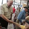 Captain Mike White of the Montgomery County Constables Pct. 2 Office greets WWII veterans meeting at Storage 105.