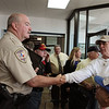 Captain Mike White of the Montgomery County Constables Pct. 2 Office greets veterans at Storage 105.