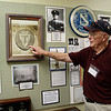 """WWII Veteran Ernie Gaston points to and explains the history of the 36th infantry division known as the """"T"""" patch from Huntsville. Texas Hwy. 36 was named after this division."""