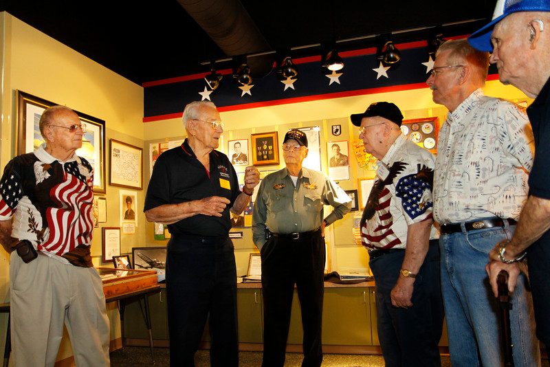 Veteran and HEARTS Museum volunteer John Parker talks with WWII veterans from the Lone Star Honor Flight.