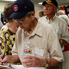 WWII Veteran J.W. Watson signs in at HEARTS museum
