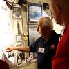 WWII veteran Daniel Daube describes operations to Storage 105 owner Jack McClanahan