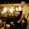WWII Veteran and prisoner of war survivor Pete Mullinax and his son-in-law view the POW room at HEARTS museum.