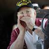 WWII Veteran Dave Hughes provides music for the veterans trip (harmonica)