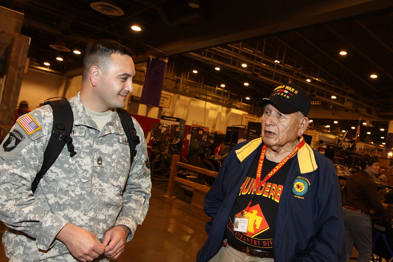 WWII Veterans participate in the Houston Livestock Show and Rodeo Armed Forces Appreciation Day. WWII veteran John Brown speaks with a current service member.
