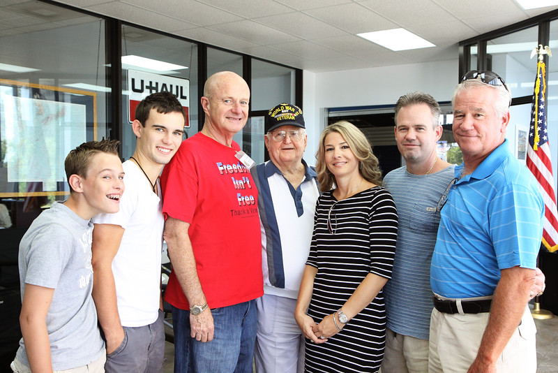 Jack and WWII veteran and Pearl Harbor surivivor Dave H. along with three generations of Dave's family.