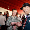Brigadier General Joseph P. Disalvo, III Corps Chief of Staff at Fort Hood, with WWII veteran Clyde Miller.