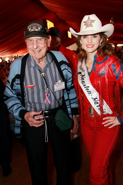 """WWII veteran airborne paratrooper, Mel Trennary and Mrs. Rodeo Houston. Mel jokes that the first time he flew in a plane he had to jump out of it. Mel's story can be read in the book """"Battling Buzzards."""""""