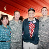 Brigadier General Joseph P. Disalvo, III Corps Chief of Staff at Fort Hood, and his wife along with WWII veteran Clyde Miller and active duty Captain Hudak.