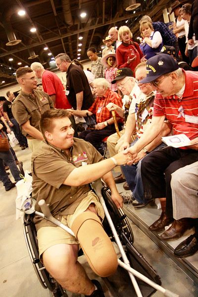 Wounded Warrior and member of Combat Marine Outdoors greeted by WWII veterans.