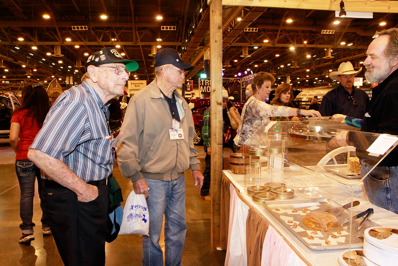 WWII veterans Mel Trennary and Doug Stewart try some Texas treats.