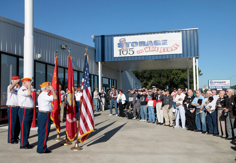 Members of the Marine Corp League along with veterans from the Lone Star Honor Flight gather for a flag raising at Storage 105 in Conroe TX. The previous flag flown by Storage 105 owner, Jack McClanahan was damaged earlier this year. The current flag raised today was donated by  Peter Caldwell and his sister Karen Caldwell Wresch along with their familiy, in honor of their father, Alvin (Pappy) Caldwell, and his wife Margurete Caldwell. Alvin Caldwell served in the US Navy during WWII from 1937-1945.