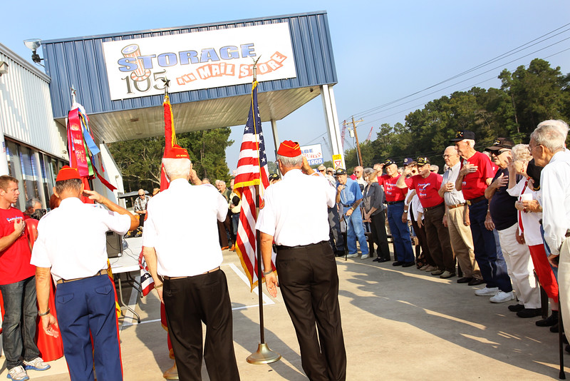 The Marine Corp League presents the colors during a ceremony flag raising in honor of WWII veteran, Pearl Harbor survivor Dave Hughes