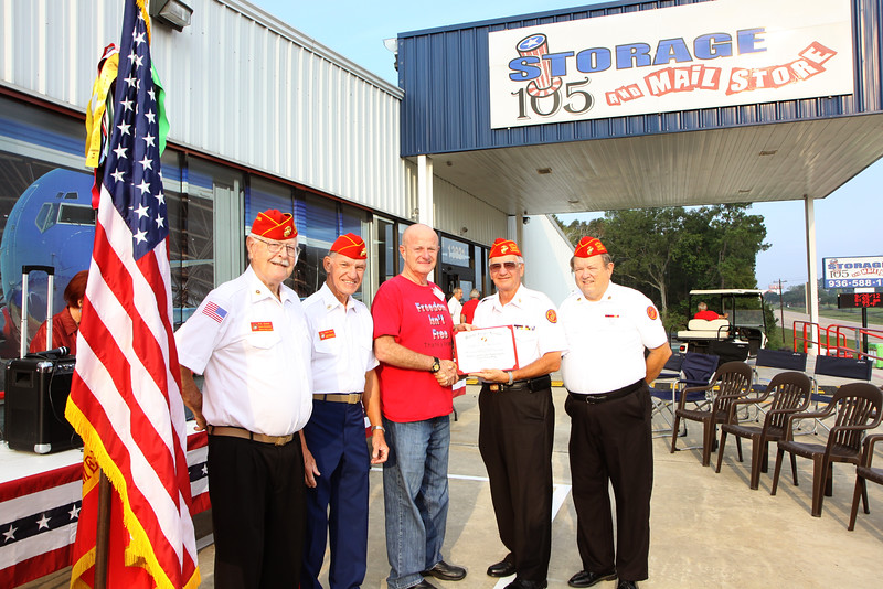 Business ownder Jack McClanahan is presented with a certificate of appreciation from the Marine Corp League, for his involvment and support of America's veterans.
