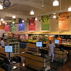 The logo is everywhere, on the cash registers, the signs, the grocery bags, and the staff.