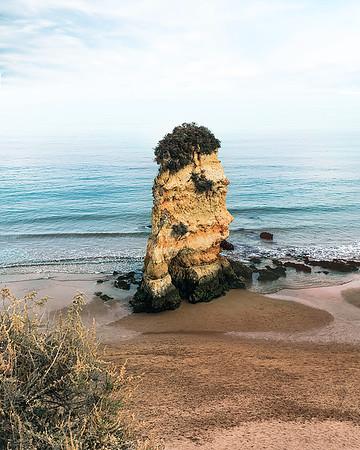 A typical golden sea stack of Praia Dona Ana, Lagos, Algarve.