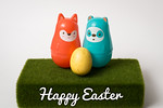 Two Plastic Easter Animals with Single Egg on Fake Grass
