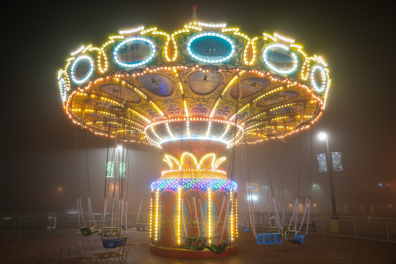 Empty Carousel in the Night Fog