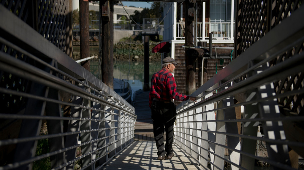 "Bob Srnka returns to the houseboat pier after getting his mail on Wednesday, June 6, 2012. ""People come and they go,"" he said. ""The people who came when I did are all gone. But I'm still here, and I don't plan on leaving."""