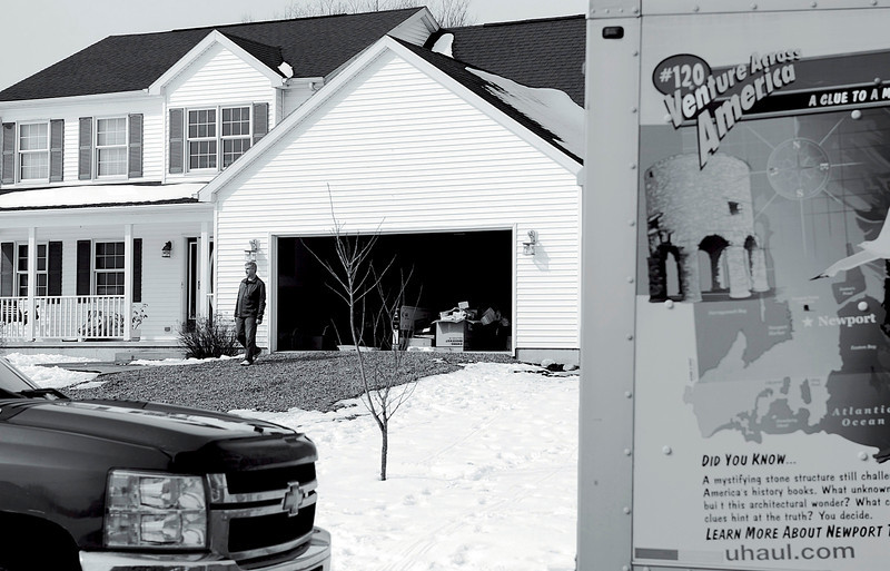 After family and friends helped him pack up and load the contents of his home, David Stankiewicz stands by himself in the driveway of the house in McKean Township on March 9, 2013. Andy Colwell/Erie Times-News