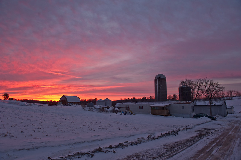 Sunrise colors the sky over Barb Rossman's farm near Spring Mills, Pa. on Feb. 9, 2011. Dairy farming is the top economic enterprise in Pennsylvania, and is the way of life for the Rossman family, who have farmed the same land in Centre County for five generations. Barb, who is in her 60s, has been a widow for nearly twenty years, yet she runs most operations on the 300-acre farm with help from only her son and a few part-time farm hands.