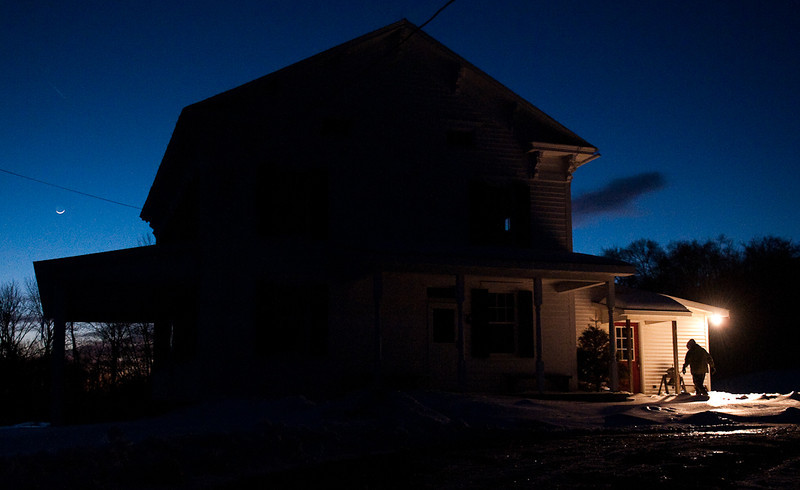 Her day nearly done, Barb Rossman returns to her darkened house shortly after sunset on Feb. 4, 2011.