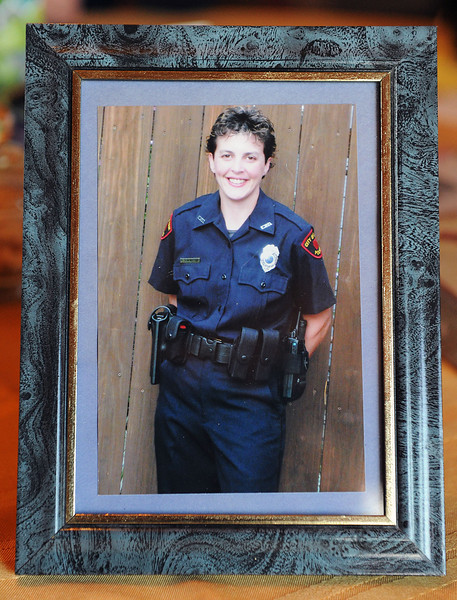 Erie police officer Mary Ann Schmeisser and her partner Dana Beck have this photograph of Schmeisser on the day she received her police uniform in 2008. Schmeisser was severely injured on the job when she was hit by a vehicle while responding to a 911 call on the night of Dec. 14, 2011. Since the accident, Schmeisser and Beck are working together to stay upbeat and positive as Schmeisser heals. ANDY COLWELL/