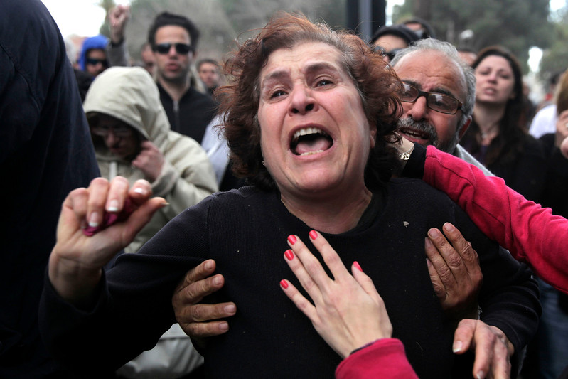 A Cypriot woman gets emotional during a protest outside the parliament building in the capital Nicosia on March 22, 2013