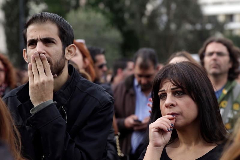 Employees of the Bank of Cyprus frown as they demonstrate outside the main office of the bank in the Cypriot capital, Nicosia, on March 26, 2013.