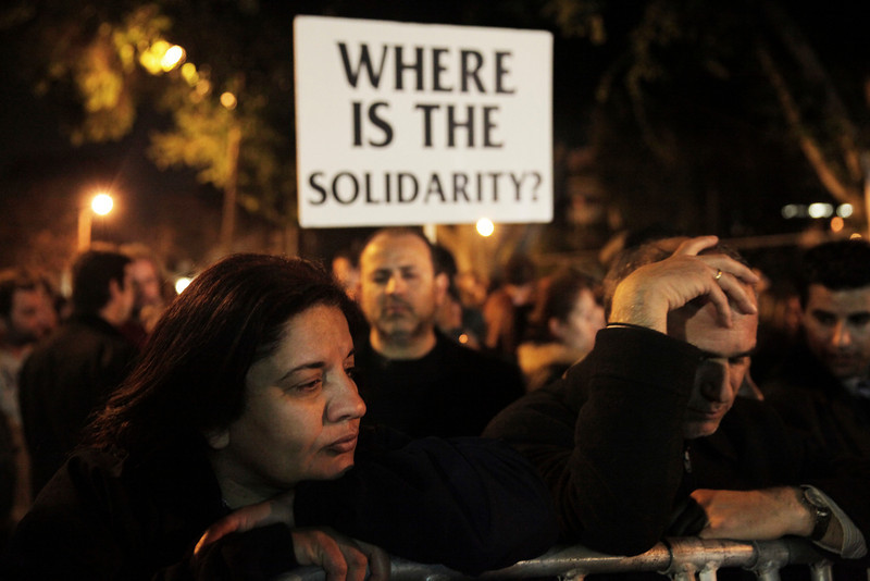 Cypriot empoyees of the Laiki (Popular) Bank cry during a protest outside the Parliament on March 21, 2013 in Nicosia.