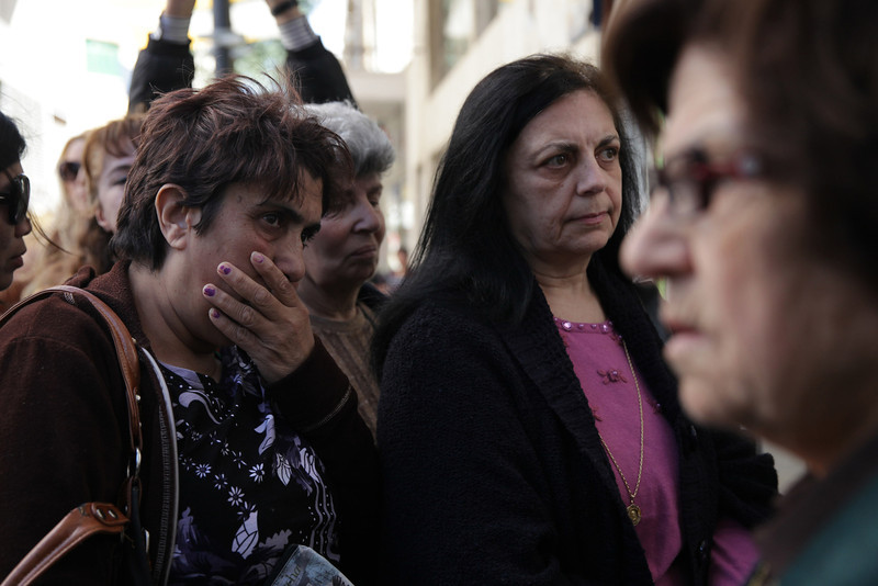 CYPRUS, Nicosia : Women wait outside a Laiki bank branch in the old part of the Cypriot capital, Nicosia, on March 28, 2013, ahead of their reopening after an unprecedented 12-day lockdown.