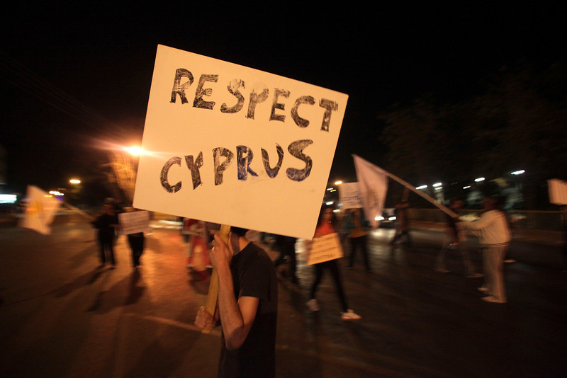 People protest during a demonstration in Nicosia on April 02,2013